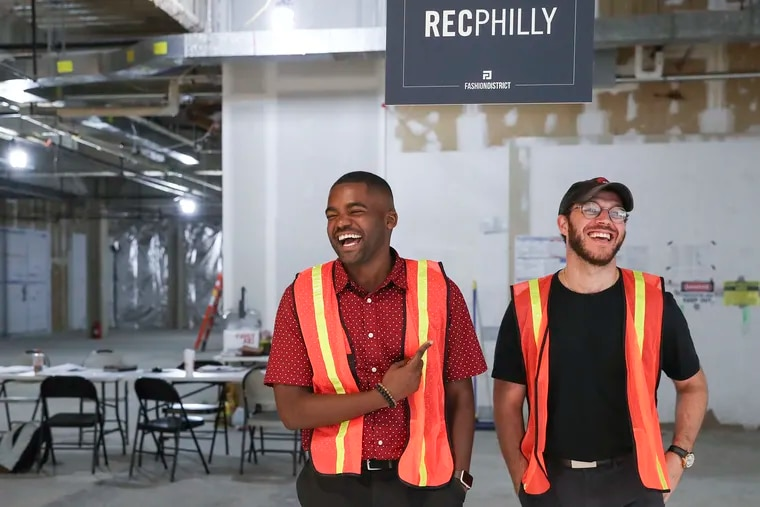 William Toms, left, and David Silver pose for a portrait inside their new space at Ninth and Market Streets that is currently under construction in Center City, Philadelphia on Thursday, July 25, 2019. REC Philly, a coworking space for creatives, has just secured $3 million in funding.