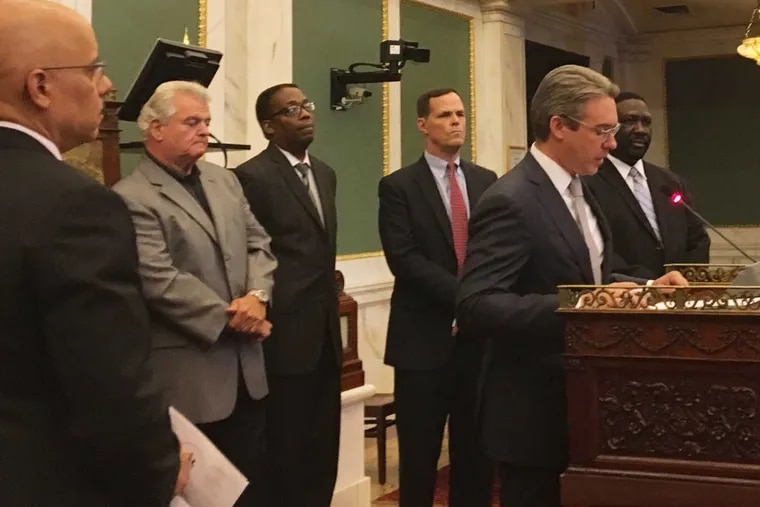 Al Schmidt, a Republican and vice chairman of the City Commissioners, joins with (from left) state Sen. Vincent Hughes, U.S. Rep. Bob Brady, City Council President Darrell Clarke, Committee of 70 CEO David Thornburgh and City Commissioner Chairman Anthony Clark to discuss the Nov. 8 election.