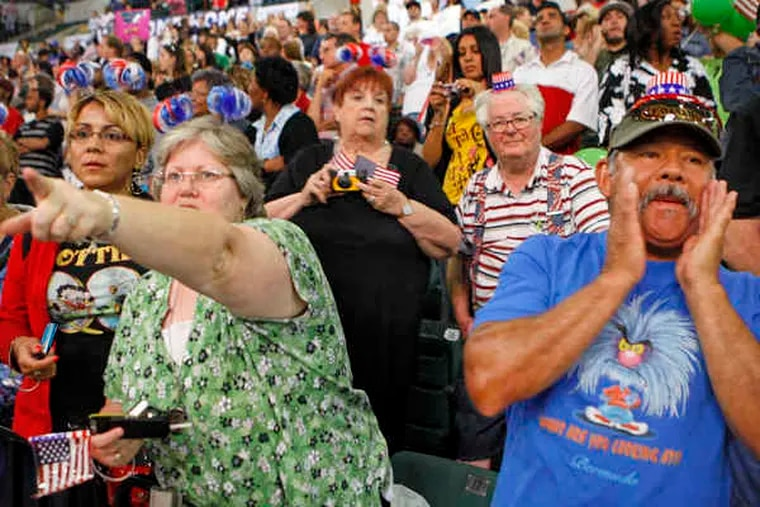 The parents of a returning soldier, Lisa and Manuel Larranaga, cheer as troops enter Sovereign Bank Arena in Trenton. The return of the brigade marks the end of N.J.'s largest deployment of Guardsmen since WWII.
