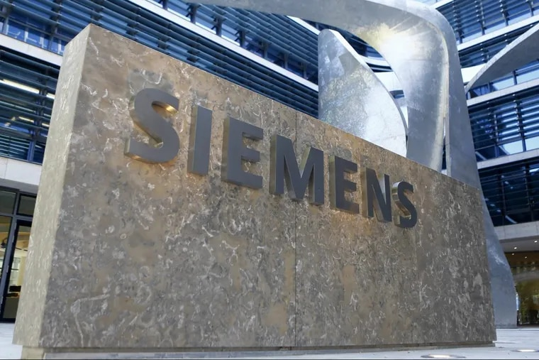 FILE – This June 24, 2016 file photo shows the logo of German industrial conglomerate Siemens at their headquarters in Munich, Germany.