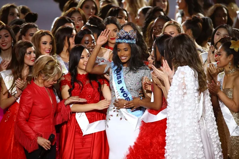 Winner of Miss World 2019, Toni-Ann Singh of Jamaica, is congratulated by other contestants after winning Miss World at the 69th annual Miss World competition in London Saturdayr.
