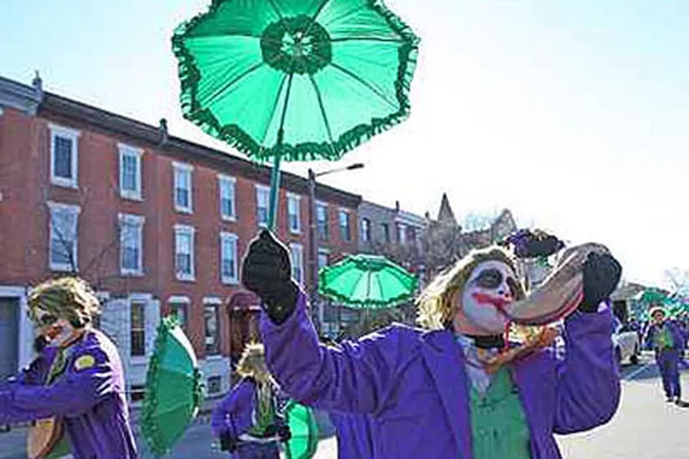 """The Mummers will begin to sell """"Mummerabilia,"""" including T-shirts, CDs and bobbleheads. (Michael Bryant / Staff Photographer)"""