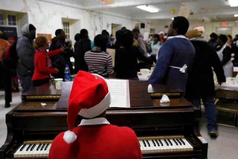 Gloria Bracy, a volunteer who is an organist at Bethel Presbyterian Church in North Philadelphia, performs at the annual Christmas Day Breakfast at Arch Street United Methodist Church.