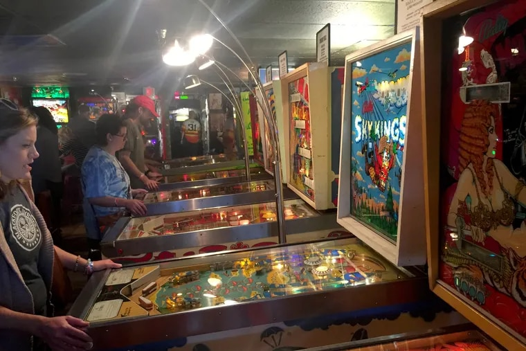 In the Asheville Pinball Museum, you pay $15 and play all you want on 80 machines ranging from the 1970s to the latest games. (Photo: Nelson Pressley / Washington Post)