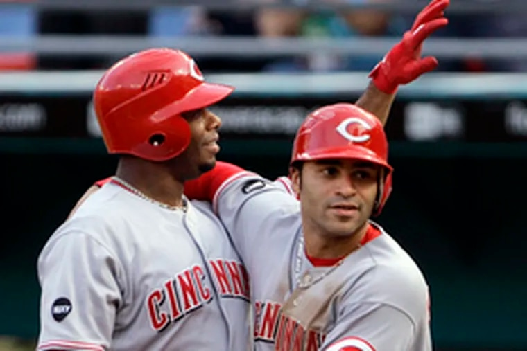 The Reds' Ken Griffey Jr. (left) is congratulated by Jerry Hairston Jr. after hitting his 600th career home run against the Marlins. The two Ken Griffeys (Jr. and Sr.) have 752 homers between them, the two Jerry Hairstons (also Jr. and Sr.) only 64.