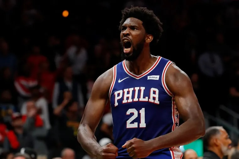 Joel Embiid reacts after the 76ers' 105-103 win over the Atlanta Hawks at State Farm Arena on Monday.