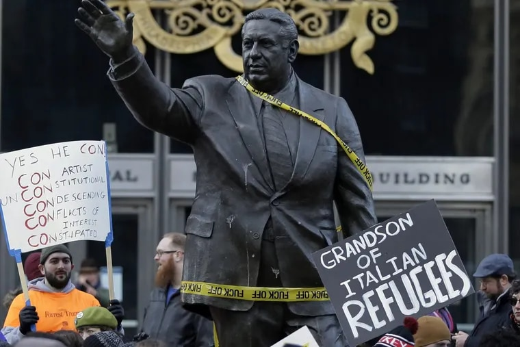 Demonstrators at the Frank Rizzo statue during a march in February.
