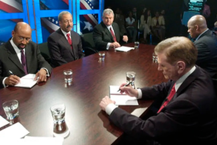 Democratic candidates in the race for mayor prepare notes before a debate Saturday. They are (from left) Michael Nutter, Chaka Fattah, Bob Brady, Tom Knox and Dwight Evans.