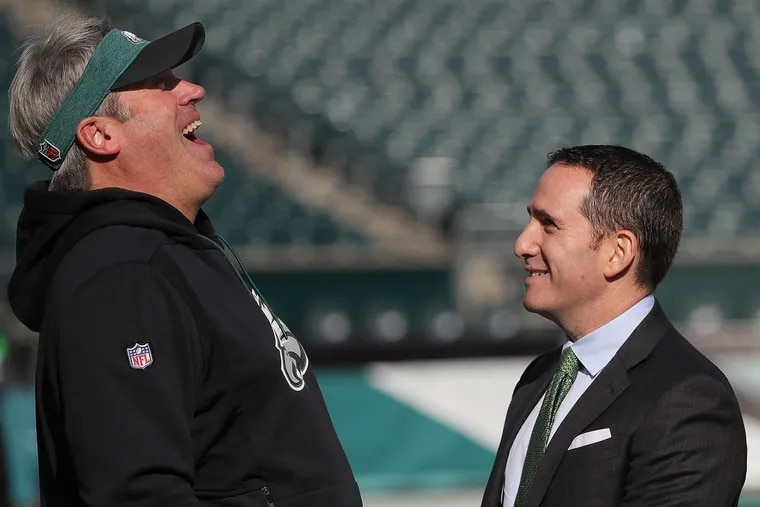"""Eagles head coach Doug Pederson and GM Howie Roseman share a laugh before a recent game. Former Eagles president Joe Banner says owner Jeffrey Lurie's confidence in Roseman """"still is very solid, and I think he probably still has confidence in Doug.''"""