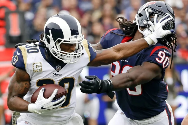 The Eagles will need to pay close attention to Rams running back Todd Gurley on Sunday. Here he pushes away Texans linebacker Jadeveon Clowney.