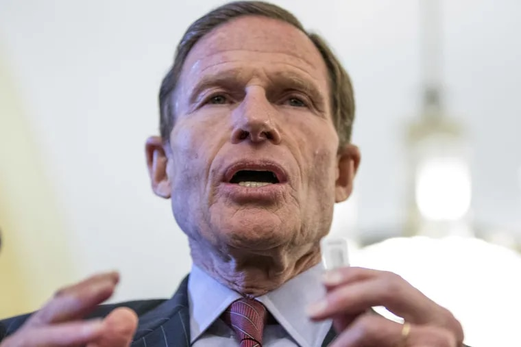 Sen. Richard Blumenthal, D-Conn. holds a thumb drive during a news conference on Capitol Hill in Washington in February.