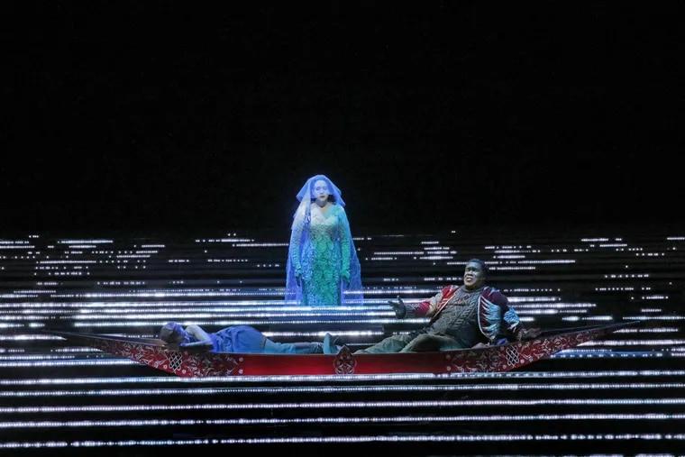 "Tamara Mumford as the Pilgrim (reclining, left), Philadelphia-born baritone Eric Owens as Jaufré Rudel (right), and Susanna Phillips as Clémence (center) in Kaija Saariaho's ""L'Amour de Loin."" The Metropolitan Opera production will be simulcast in Philadelphia-area theaters on Dec. 10."