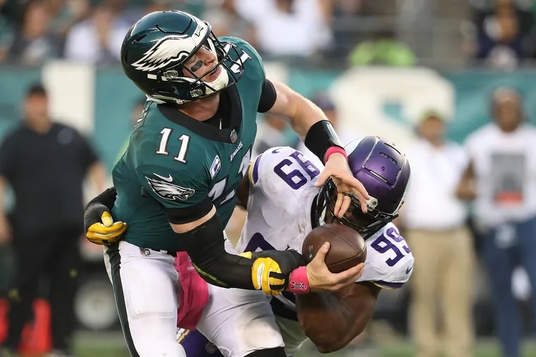 Carson Wentz is sacked by the Vikings' Danielle Hunter in the third quarter.