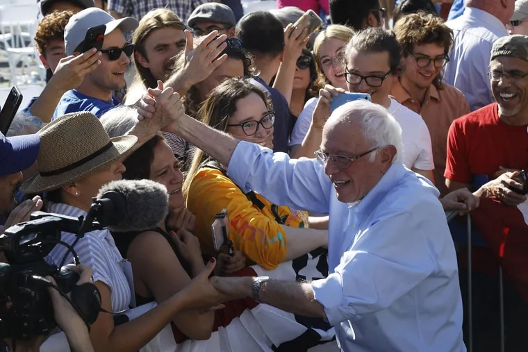 A smiling Senator Bernie Sanders greets supporters at the end of his 2020 Rally at Woodrow Wilson Senior High School on Nov. 16, 2019 in Los Angeles. (Genaro Molina/Los Angeles Times/TNS)