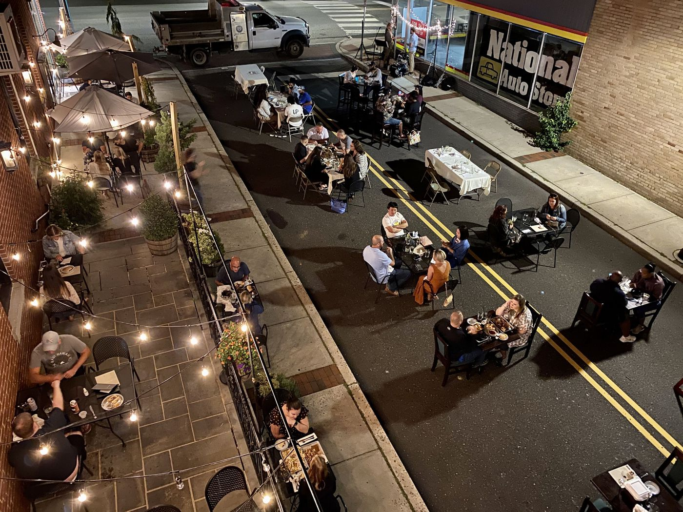 Diners fill seating on the patio and in Wood Street outside of Stove & Tap restaurant in Lansdale on Sept. 12, 2020. The photo was taken from the restaurant's second floor, now unused because of the pandemic.