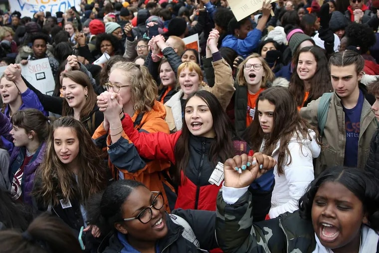 Students chant during a national student walkout in support of gun control at City Hall on Wednesday, March 14, 2018.