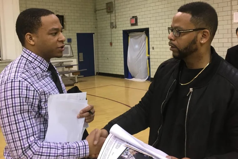 Zane Johnson (left) of Philadelphia Lawyers for Social Equity speaks with Leon Sullivan at a pardon and expungement workshop at Shepard Recreation Center on Monday during MLK Day. (MENSAH M. DEAN / Staff)