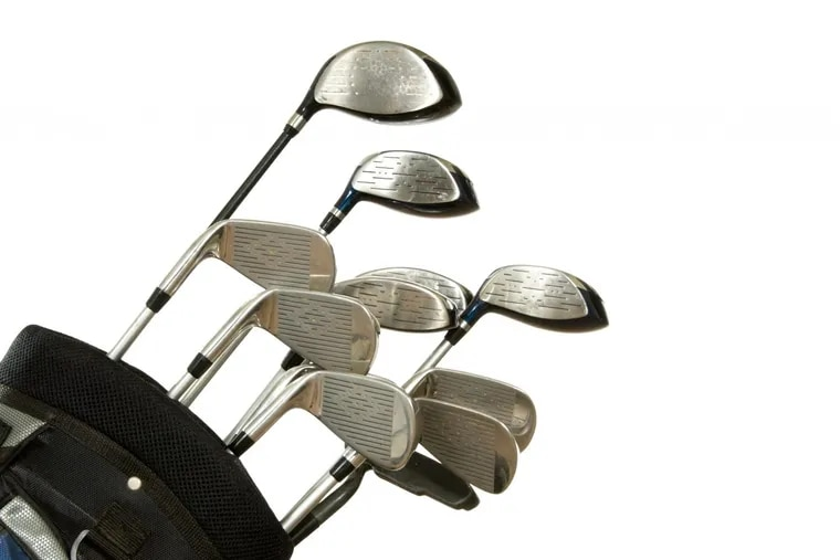 full set on golf clubs in a bag on white backgrund