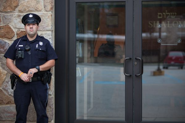 Synagogues are meant to welcome strangers. A year after Pittsburgh shooting, they lock their doors.