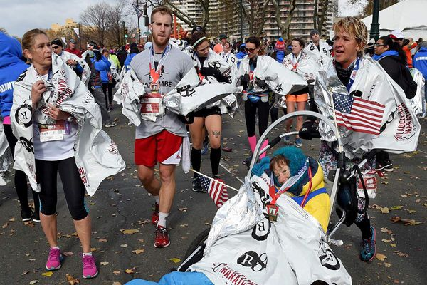Attack survivor, 69, conquers Phila. Marathon in racing wheelchair, with helpers