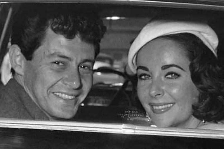 Liz Taylor, who died today, was married to Philadelphia's Eddie Fisher.  They are seen here through the window of their auto on their wedding day in May, 1959.  (AP Photo)