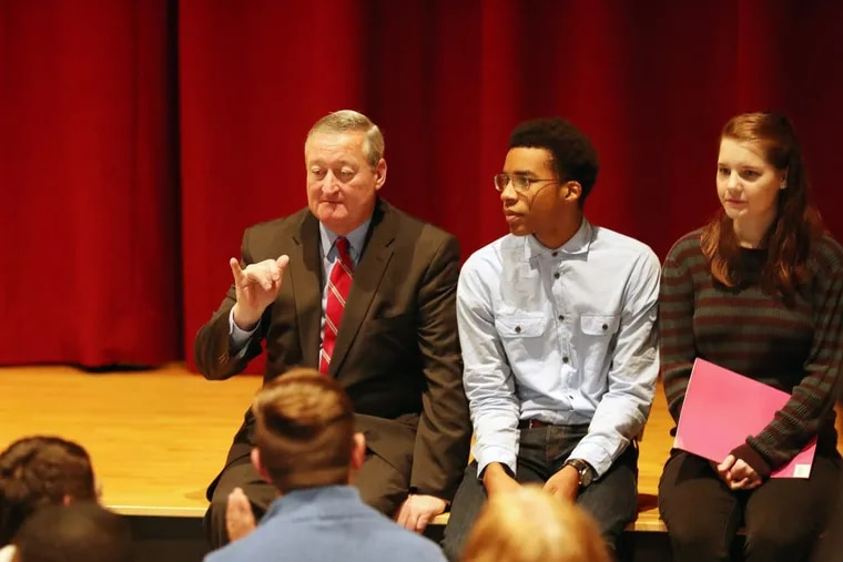 Mayor Kenney sits with students Justice Passe and Megan Davis at Lincoln High School on Nov. 9.