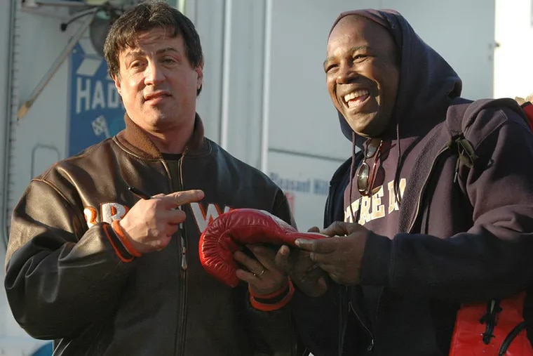 """Matthew Saad Muhammad (right) meeting with actor Sylvester Stallone during filming of a """"Rocky"""" movie in 2006. (File Photo)"""