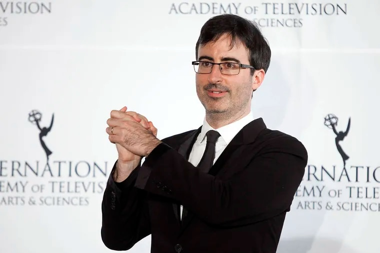 """Comedian John Oliver aims """"to do a deeper dive into stories."""""""