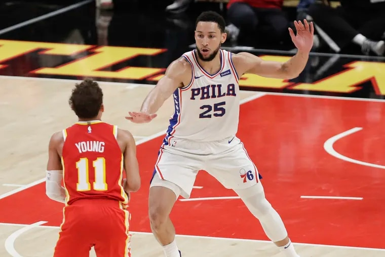 Sixers guard Ben Simmons defends Atlanta Hawks guard Trae Young in Game 3 of the NBA Eastern Conference playoff semifinals on Friday, June 11, 2021 in Atlanta.