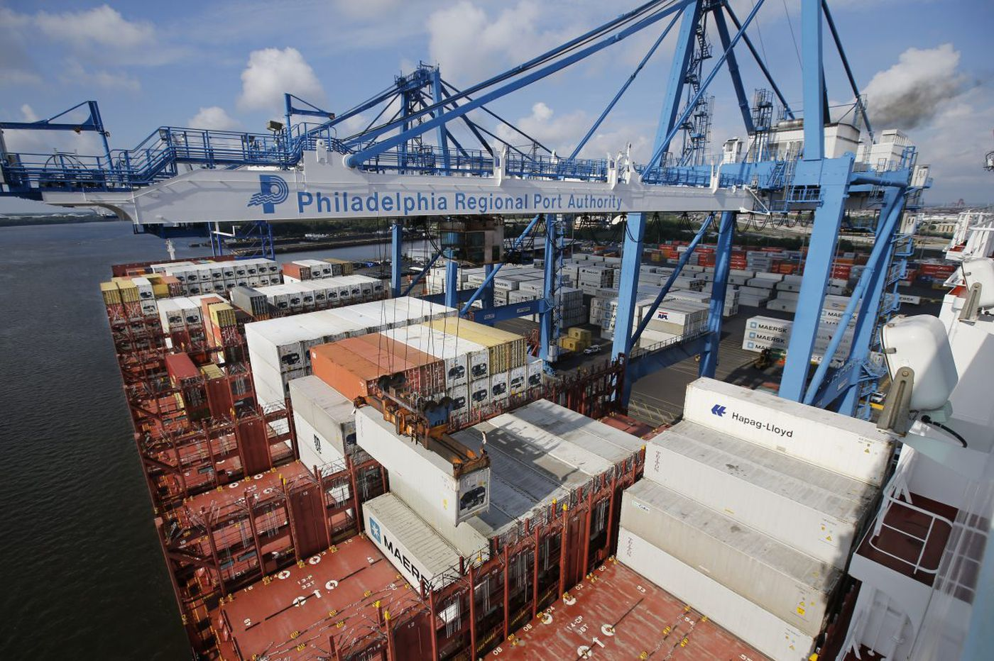 Shipping container falls on truck at port, killing worker