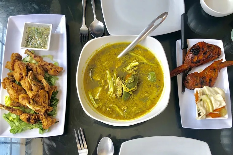 Cambodian fried frog legs, lemongrass noodle-stuffed chicken wings, and sour and spicy lemongrass stew called somlaw machu kroeung at Sophie's Kitchen in South Philadelphia.