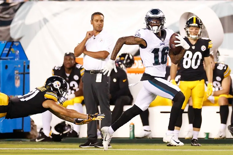 Eagles wide receiver Quez Watkins runs with a reception for a 79-yard touchdown past Pittsburgh Steelers cornerback Tre Norwood.