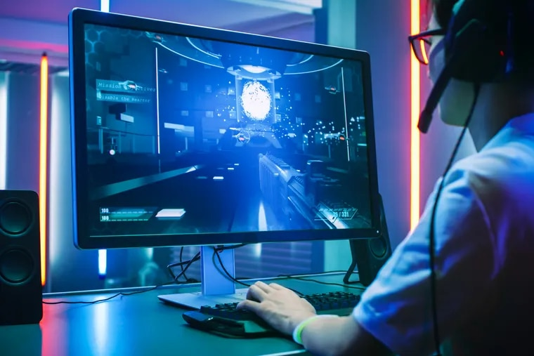 A professional gamer plays a first-person shooter online video game. Pa. lawmakers have introduced a bill to impose a tax on violent, mature-rated games.