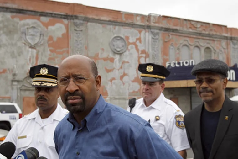 Mayor Nutter, center, pauses before speaking at a news conference outside the Felton, a nightclub in the Feltonville section of Philadelphia. (David Maialetti / Staff Photographer)