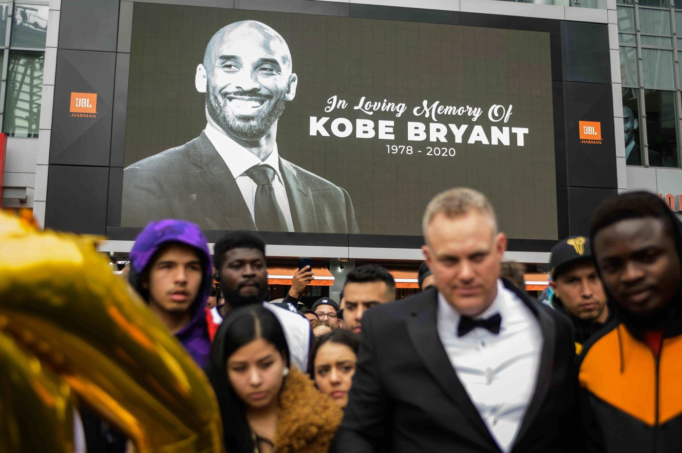 Fans meet at L.A. Live in Downtown Los Angeles to mourn the loss of Los Angeles Lakers basketball legend Kobe Bryant, 41, and daughter Gianna, 13, on Sunday.