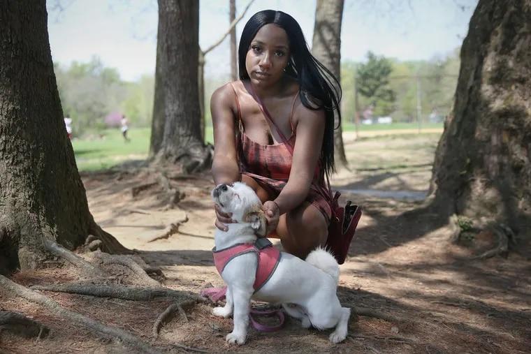 Lauren-Rebecca Davis with her dog, Lola, at Charles A. Papa Playground in West Philadelphia. Davis has felt lonely since her friends are able to still go out late while she is pregnant with twins.