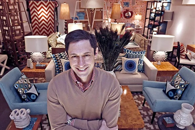 """Ready to please: Jonathan Adler, known for his """"Top Design"""" judging on Bravo, shows off a grouping in his new boutique with aqua midcentury modern seating and graphic accents. (Akira Suwa / Staff Photographer)"""