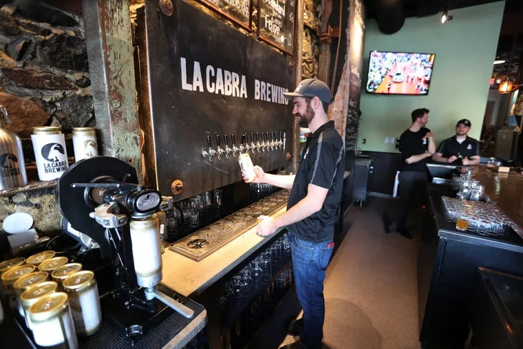 General manager Chuck Golder fills a crowler at La Cabra Brewing, 642 Lancaster Ave., Berwyn.