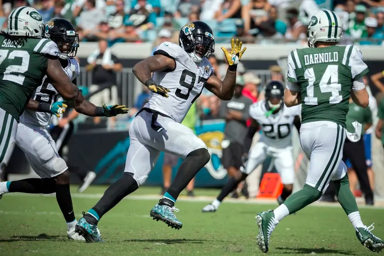 Malik Jackson chases after Jets quarterback Sam Darnold during a September 2018 game. His ability to pursue quarterbacks from the inside is one of the reasons the Eagles signed him.
