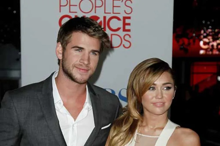 Liam Hemsworth (left) and Miley Cyrus in 2012. (AP Photo/Matt Sayles)