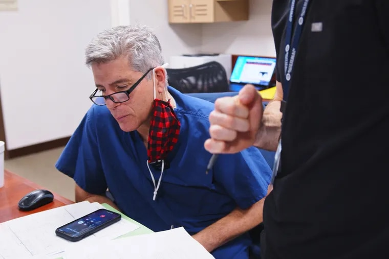 Alexander Vaccaro, president of Rothman Orthopedic Institute and an orthopedic surgeon, talks to a patient during a virtual visit. Virtual visits have been popular with patients, and Vaccaro now meets about half his patients the day of their surgery, he said.