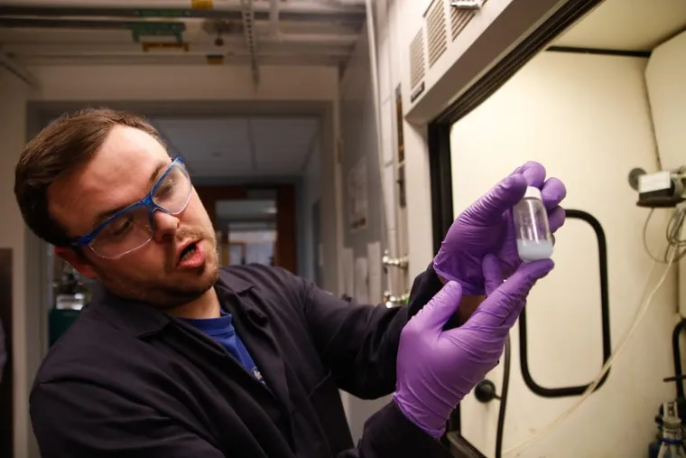 University of Pennsylvania Ph.D. student Bren Cole demonstrates a process for separating rare earth metals, used to make smartphones, TVs, and wind turbines.