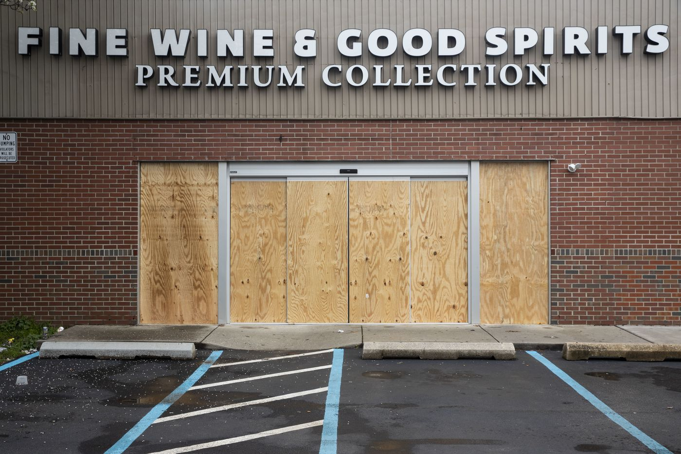 The Fine Wine and Good Spirits Premium Collection at South 11th Street and Wharton Street is boarded up in Philadelphia, Pa. on Thursday, March 19, 2020. Gov. Tom Wolf ordered the closing of all Fine Wine & Good Spirits stores and service centers in Pennsylvania to slow the spread of the coronavirus, effective Tuesday, March 17. The state said it would evaluate the closings at the end of the month.