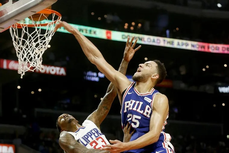 Ben Simmons (25) lays in a shot over the Clippers' Lou Williams in the second quarter Monday night.
