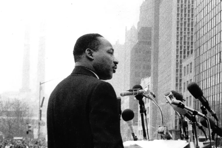 """The Rev. Dr. Martin Luther King Jr. leads a crowd of 125,000 Vietnam War protesters in front of the United Nations in New York on April 15, 1967, as he voices a repeated demand to """"stop the bombing."""""""