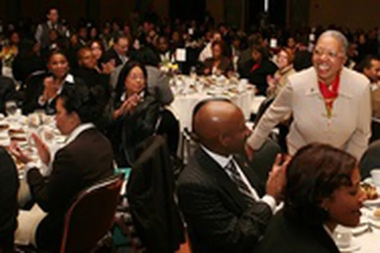 Patricia A. Coulter , president and CEO, is congratulated at the Urban League's Whitney M. Young Jr.'s Community Empowerment Awards Luncheon.
