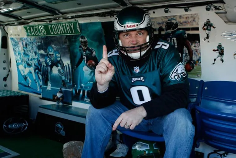 Tom Gearhart poses in his Eagle van before the start of the game. Fans are questioned about this season and the possible departure of Andy Reid. (Ron Cortes/Staff Photographer)