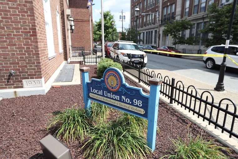 Police tape cordons off the offices of the International Brotherhood of Electrical Workers Local 98 on Friday.