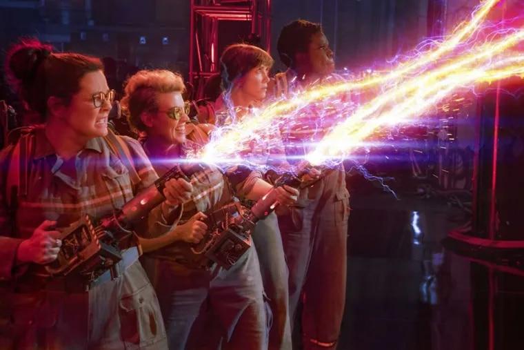"Melissa McCarthy (from left), Kate McKinnon, Kristen Wiig and Leslie Jones appear in a scene from ""Ghostbusters."""