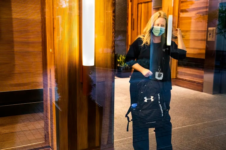 Christine Rolon, a nurse at Penn Presbyterian Medical Center, leaving Homewood Suites by Hilton on Walnut Street.